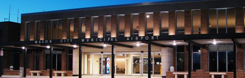 Mason City Municipal Airport MCW terminal building at night.