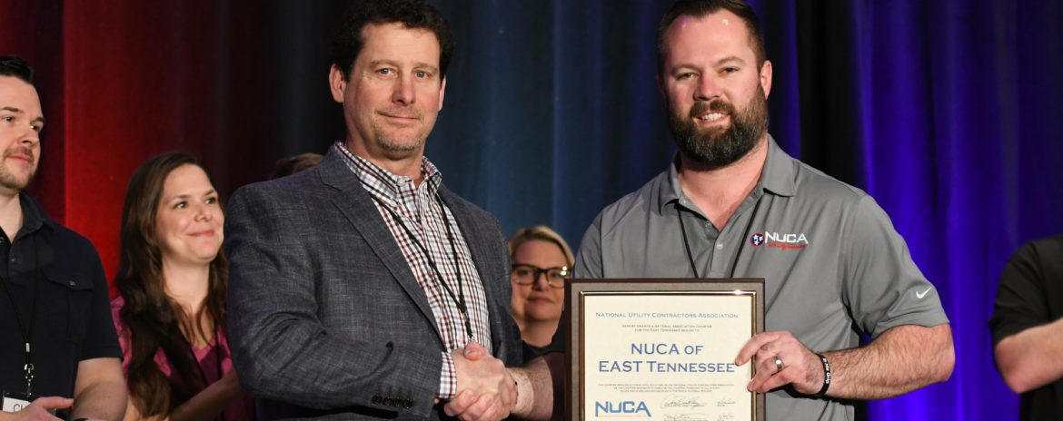 At NUCA's 2020 Convention in Tucson, Arizona, the association formally added two new chapters, in East Tennessee and New Jersey. Membership growth is a top priority of NUCA CEO Carlson. Two man facing the camera with a certificate/award shaking hands.