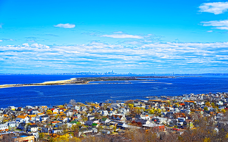 Houses and Atlantic Ocean shore at Sandy Hook reflex