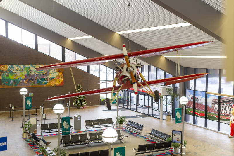 Lincoln Airport interior with biplane hanging from ceiling.