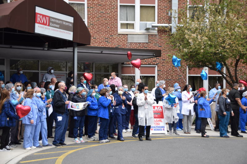 Rahway, New Jersey Rahway New JErsey University Hospital with a group of people out front wearing masks.