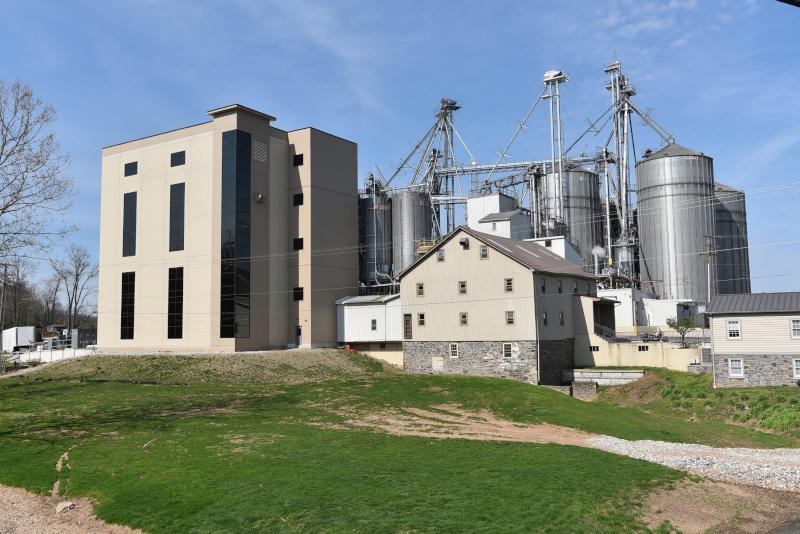 Conewago Manufacturing LLC AgCom building exterior showing a farm building with silos.