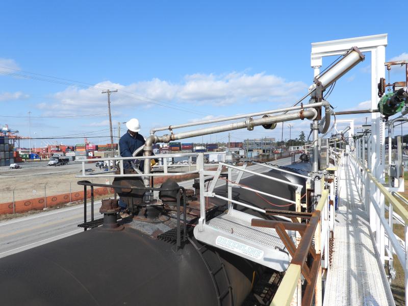 Chemserve Terminal worker loading/unloading train car