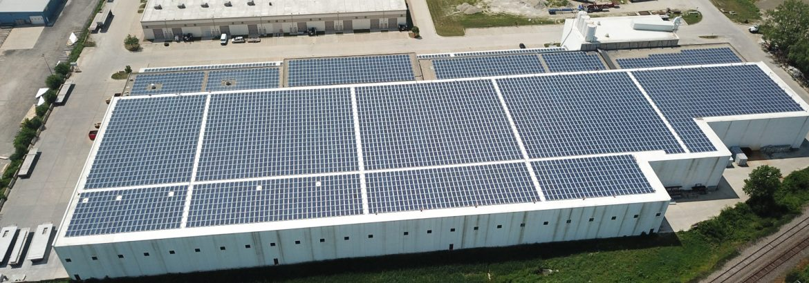 Dukane Precast Aerial building view, solar panels covering roof.
