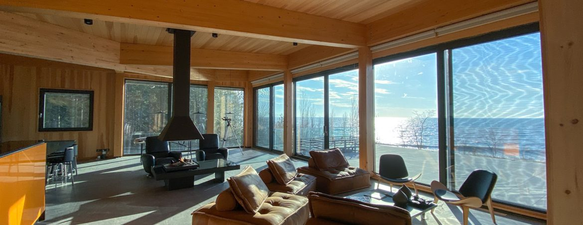 Element5 room showing wood and large glass doors with a view.