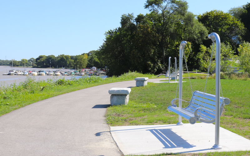 Perrysburg, Ohio bench and walkway with boats behind