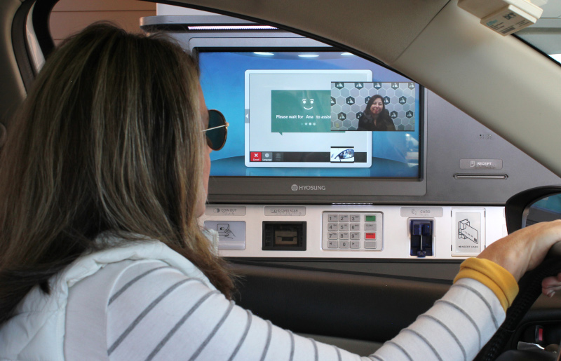 A Triangle Credit Union member uses the Interactive Teller Machine (ITM) at the Merrimack, NH branch