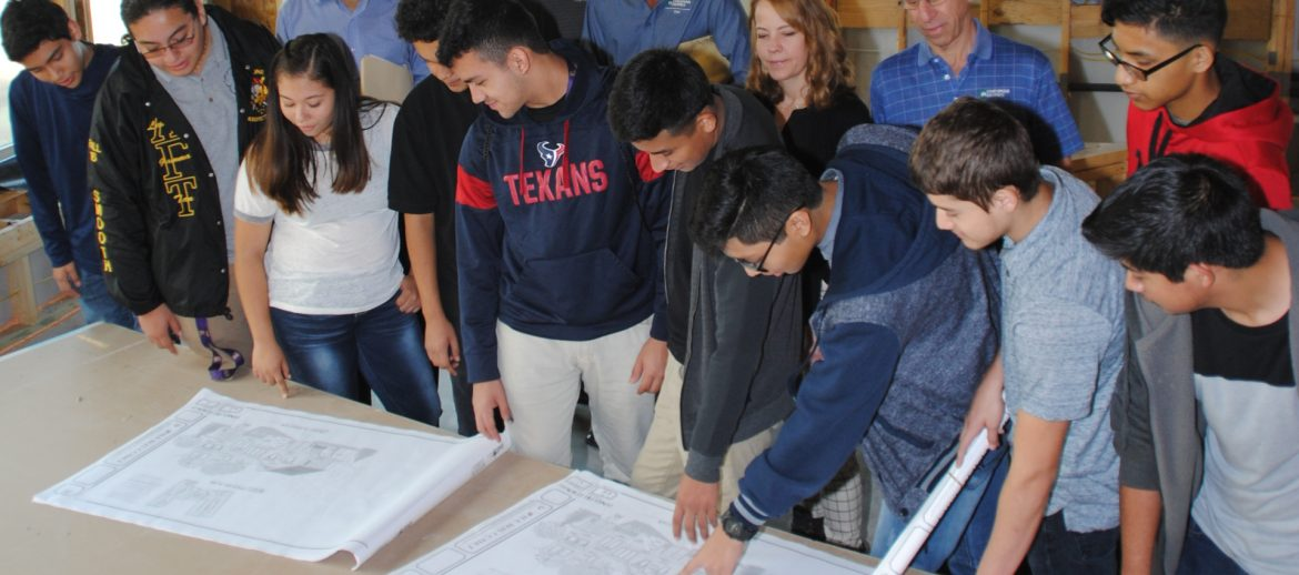 Greater Houston Builders Association (GHBA) people looking at plans on a table