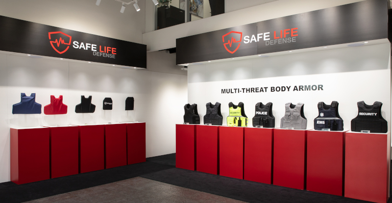 Safe Life Defense display with multiple pieces of body armor on top of cabinets