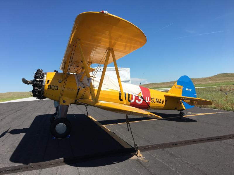 Thomas County Airport navy biplane on runway
