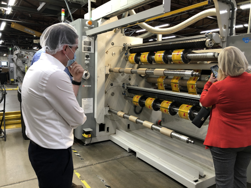 Gardner, Massachusetts Garlock Printing, two people looking at printing equipment.