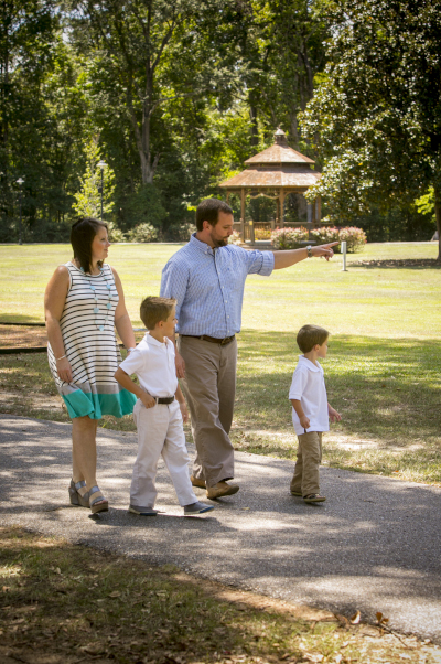 Millbrook, Alabama family in the park walking