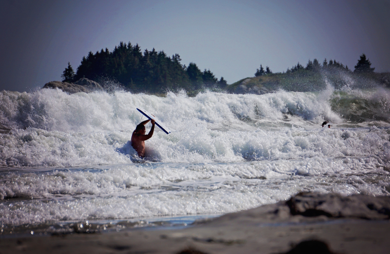 Shelburne, Nova Scotia a person in the surf riding the waves
